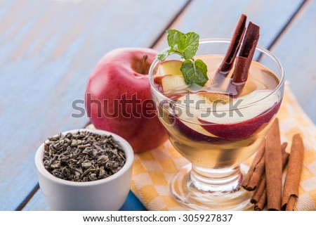 Summer fresh fruit Flavored infused water mix of green tea, cinnamon, and apple - stock photo