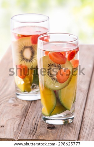Summer fresh fruit Flavored infused water mix of kiwi, mango and strawberry - stock photo