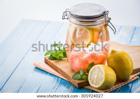 Summer fresh fruit Flavored infused water mix of lemon and grapefruit - stock photo