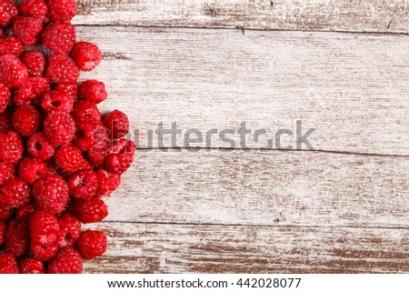 Summer fresh fruits. Raspberry on wooden table. Healthy lifestyle - stock photo