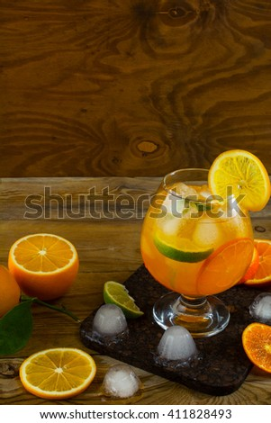 Summer fruit cocktail on wooden table, copy space. Fruit cocktail. Fruit drink. Summer drink. Citrus lemonade. Fruit lemonade. - stock photo