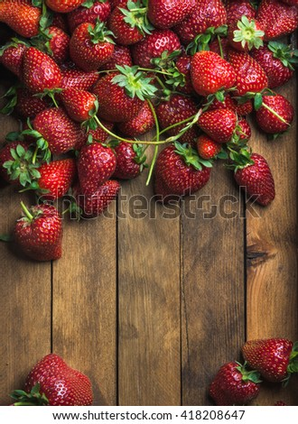 Summer fruit food frame. Strawberries over natural wooden background. Top view, copy space. Vertical - stock photo