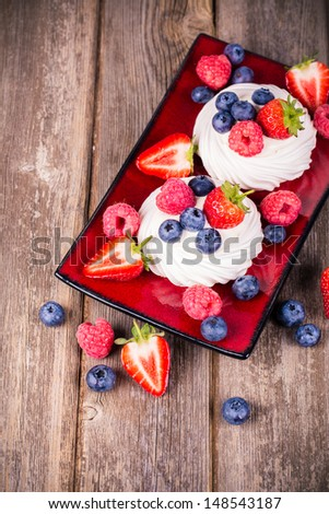 Summer fruit platter over old wood. Vintage style processing with intentional vignetting - stock photo