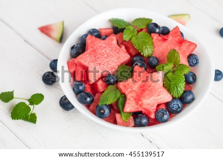 Summer fruit salad of watermelon and blueberries. Slices of watermelon in the shape of a star - stock photo