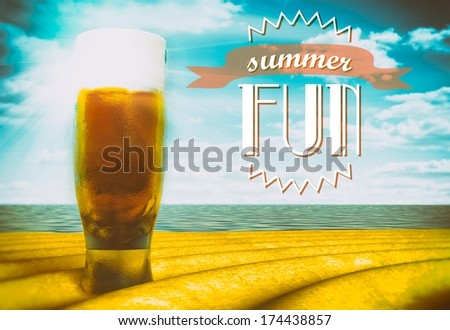 Summer fun sign with beer glass on beach - stock photo