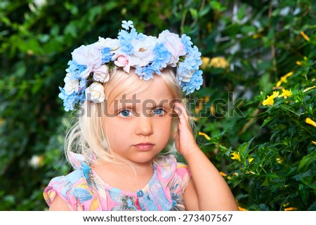 Summer girl - girl with a wreath of flowers - stock photo
