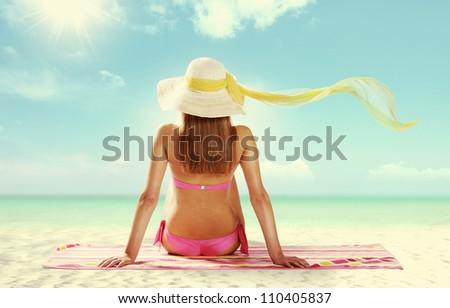 Summer girl on the beach - stock photo
