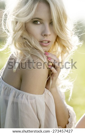 Summer girl portrait. Young attractive Caucasian woman outdoor. - stock photo