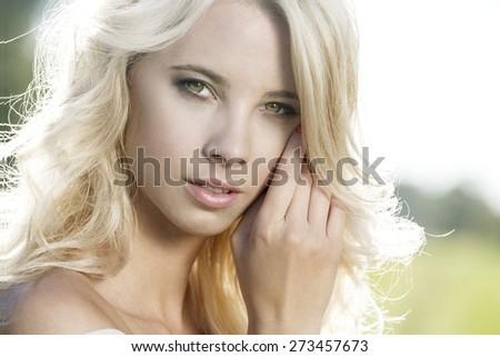 Summer girl romantic portrait. Young attractive Caucasian woman outdoor. - stock photo