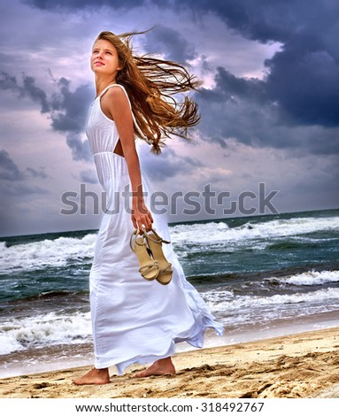 Summer girl sea.  Woman goes on coast. - stock photo