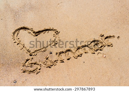 Summer handwritten in the sand of the beach with a lovely heart - stock photo