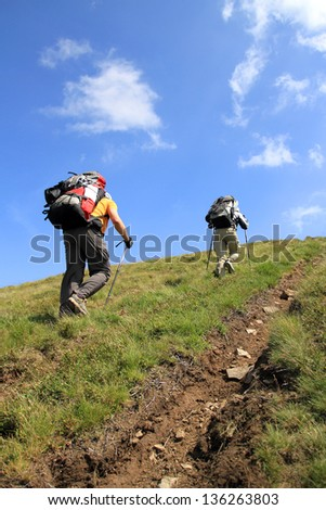 Summer hiking in the mountains. - stock photo