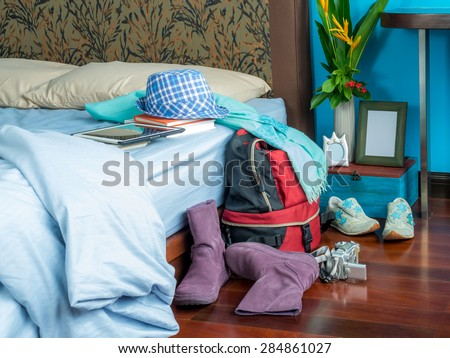 Summer holiday backpack in bedroom, concept of dream destination - stock photo