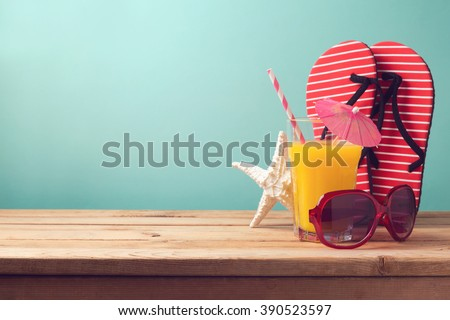 Summer holiday vacation background with orange juice and flip flops - stock photo