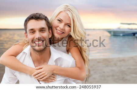 summer holiday, vacation, dating and travel concept - happy couple having fun over tropical beach background - stock photo