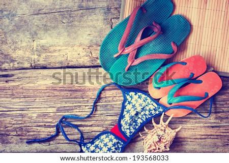 Summer holidays  accessories, flip flops on wooden background - stock photo