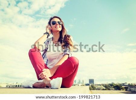 summer holidays and teenage concept - smiling teenage girl in sunglasses with headphones outdoors - stock photo