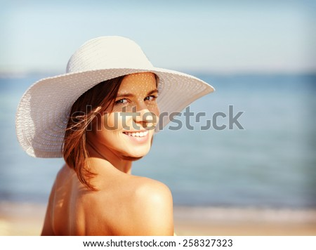 summer holidays and vacation concept - girl in bikini standing on the beach - stock photo