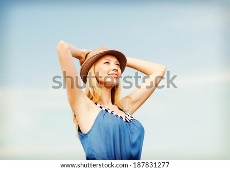 summer holidays and vacation - girl in hat standing on the beach - stock photo
