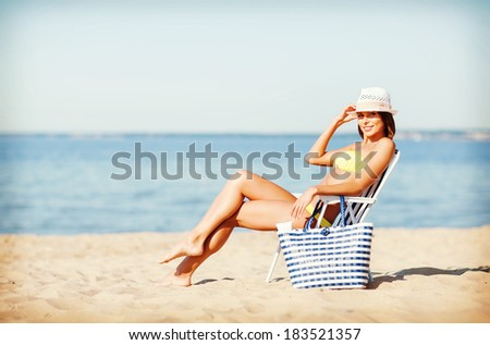 summer holidays and vacation - girl sunbathing on the beach chair - stock photo