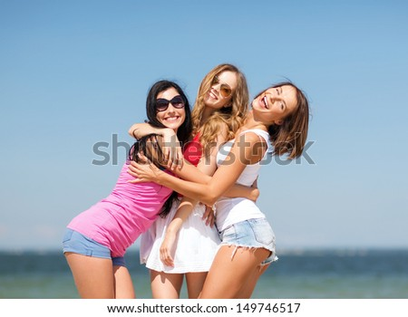 summer holidays and vacation - group of girls having fun on the beach - stock photo