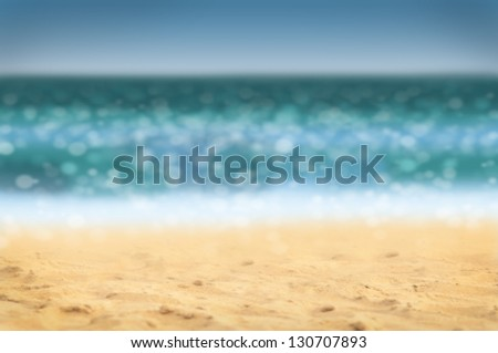 Summer holidays background - beach and sea, defocused. - stock photo