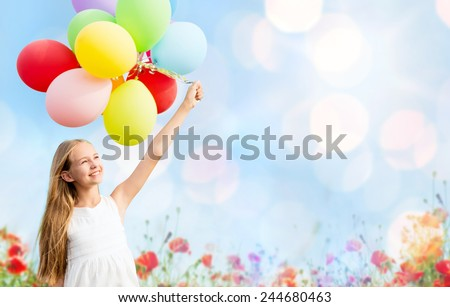 summer holidays, celebration, children and people concept - happy girl with colorful balloons over blue lights and poppy field background - stock photo