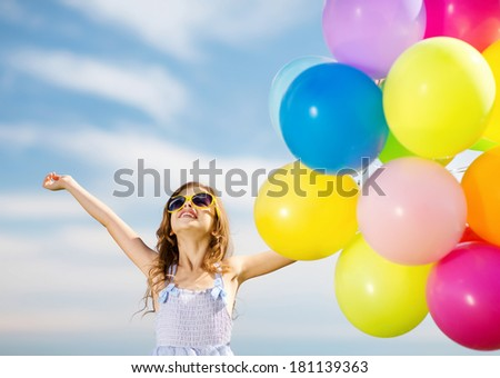 summer holidays, celebration, family, children and people concept - happy girl with colorful balloons - stock photo