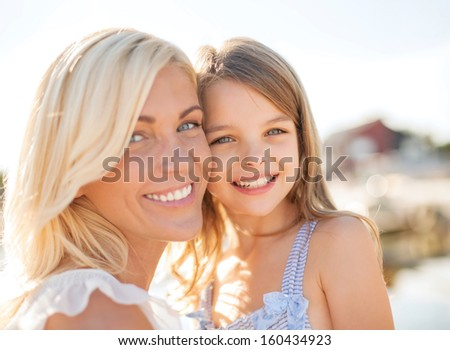 summer holidays, family, children and people concept - happy mother and child girl - stock photo