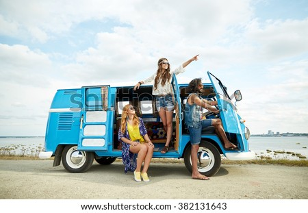 summer holidays, road trip, vacation, travel and people concept - smiling young hippie friends in minivan car on beach - stock photo