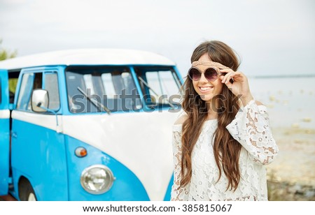 summer holidays, road trip, vacation, travel and people concept - smiling young hippie women in minivan car - stock photo
