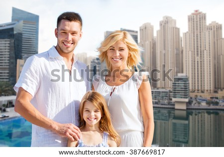 summer holidays, tourism, vacation, travel and people concept - happy family over dubai city waterfront background - stock photo