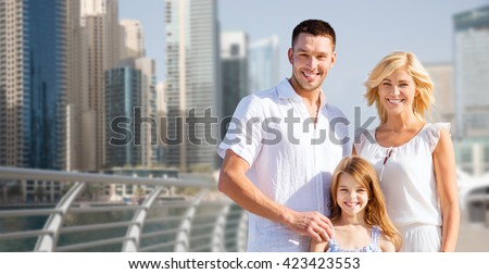 summer holidays, travel, tourism, vacation and people concept - happy family over dubai city street background - stock photo