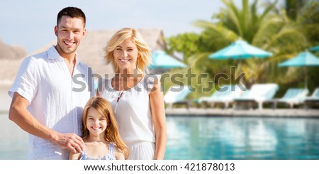 summer holidays, travel, tourism, vacation and people concept - happy family over hotel resort swimming pool and sun beds background - stock photo