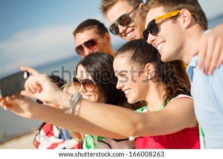 summer, holidays, vacation and happiness concept - group of friends taking selfie with smartphone - stock photo
