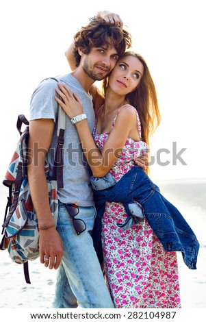 Summer  image of romantic hipster sweet couple in love hugs and enjoy happy time together  bright sunset colors, stylish outfits. - stock photo