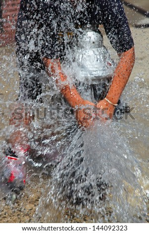 Summer in the City/Brooklyn residents open fire hydrants in high summer to provide kids & some adults, a way to escape the oppressive heat & humidity. - stock photo