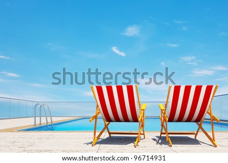 Summer is coming concept, 3d swimming pool with beach chairs - stock photo