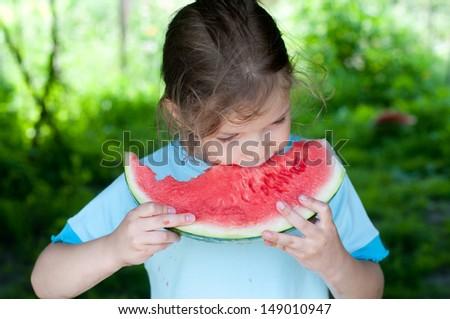 Summer joy, lovely girl eating fresh watermelon, happy child concept - stock photo