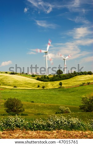 Summer landscape and wind turbines - stock photo