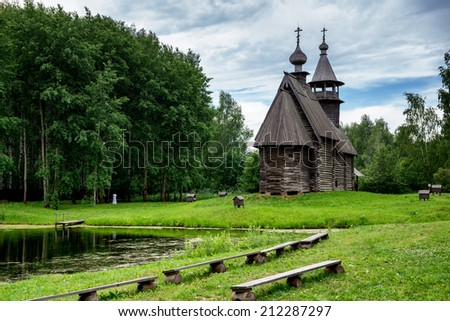 Summer landscape with a wooden church in Russia. - stock photo