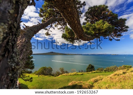 Summer Landscape with Blue Sky on the Pacific Sea Coast. A view to Rangitoto Island and Hauraki Gulf from Devonport, Auckland, New Zealand - stock photo