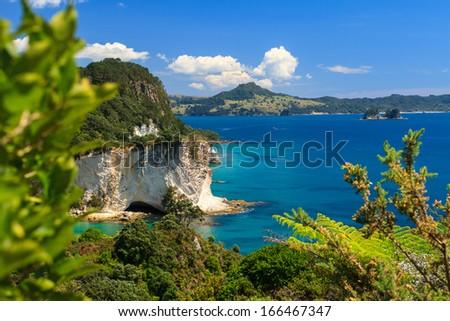 Summer Landscape with Blue Sky on the Pacific Sea Coast, Stingray Bay, Cathedral Cove, Coromandel Peninsula, North Island, New Zealand - stock photo