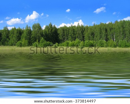 Summer landscape with bright blue sky and trees reflected in water - stock photo