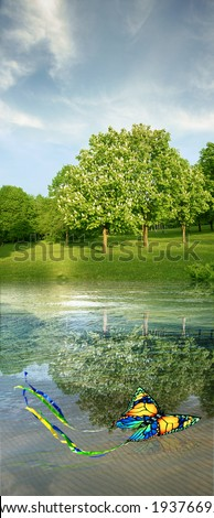 summer landscape with butterfly kite, blooming horse-chestnuts, water & sky - stock photo