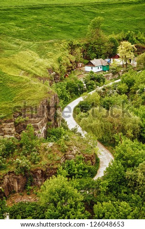 summer landscape with houses and road, high angle view - stock photo