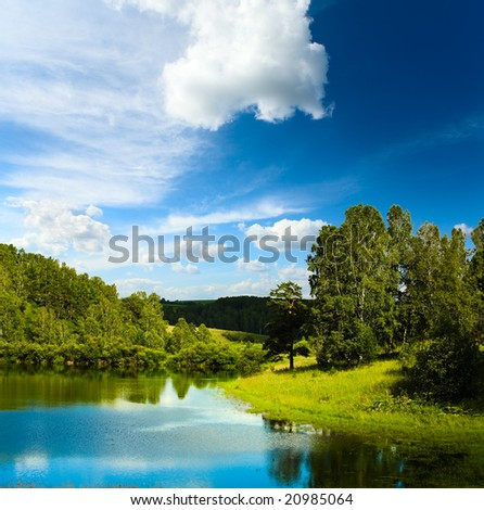 Summer landscape with lake - stock photo