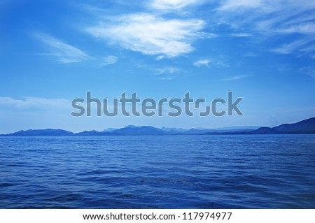 Summer landscape with sea and mountain range - stock photo