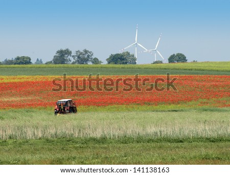 Summer landscape with truck and wind turbine - stock photo