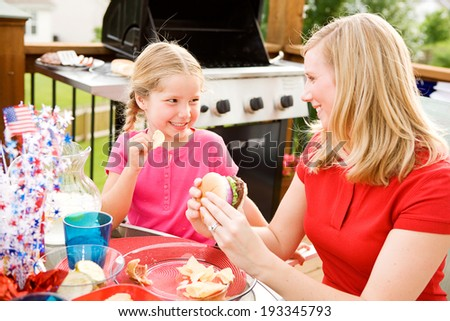Summer: Little Girl Steals Chip From Mother - stock photo